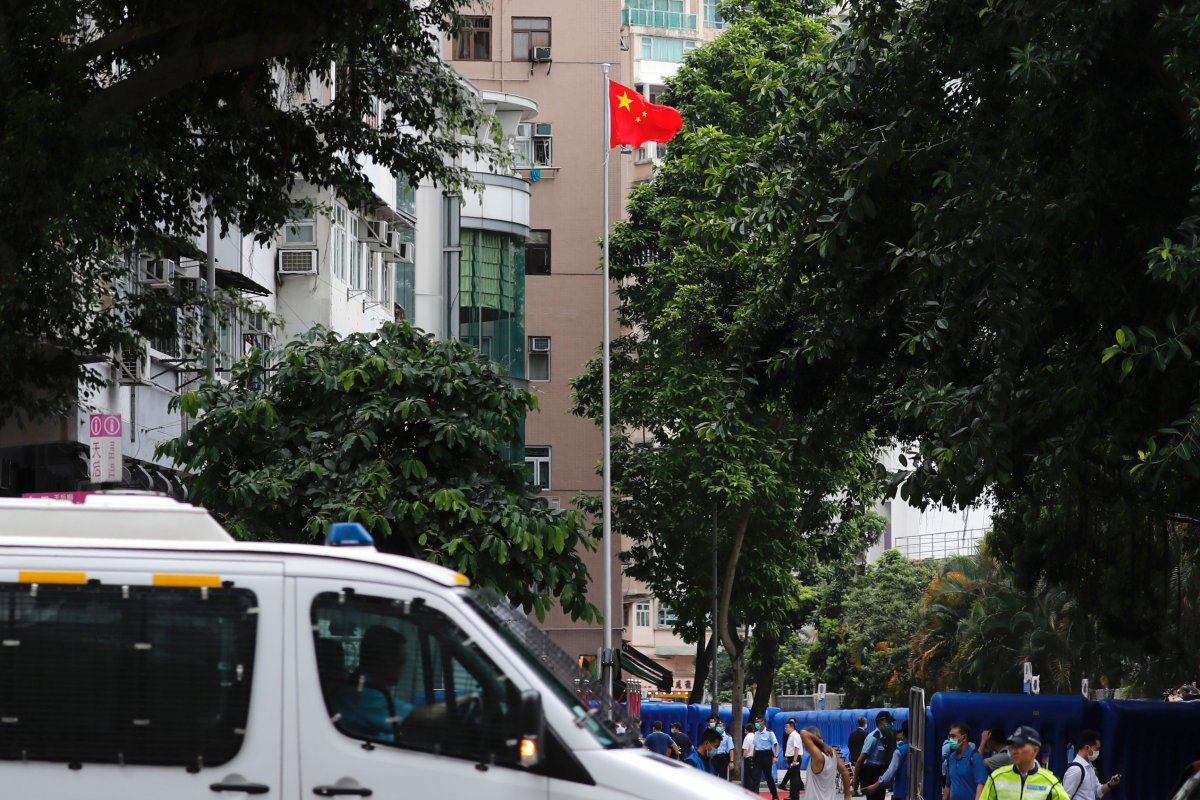 The Chinese national flag flies on a flagstaff after the opening ceremony of a temporary national security office, in Hong Kong, China July 8, 2020.