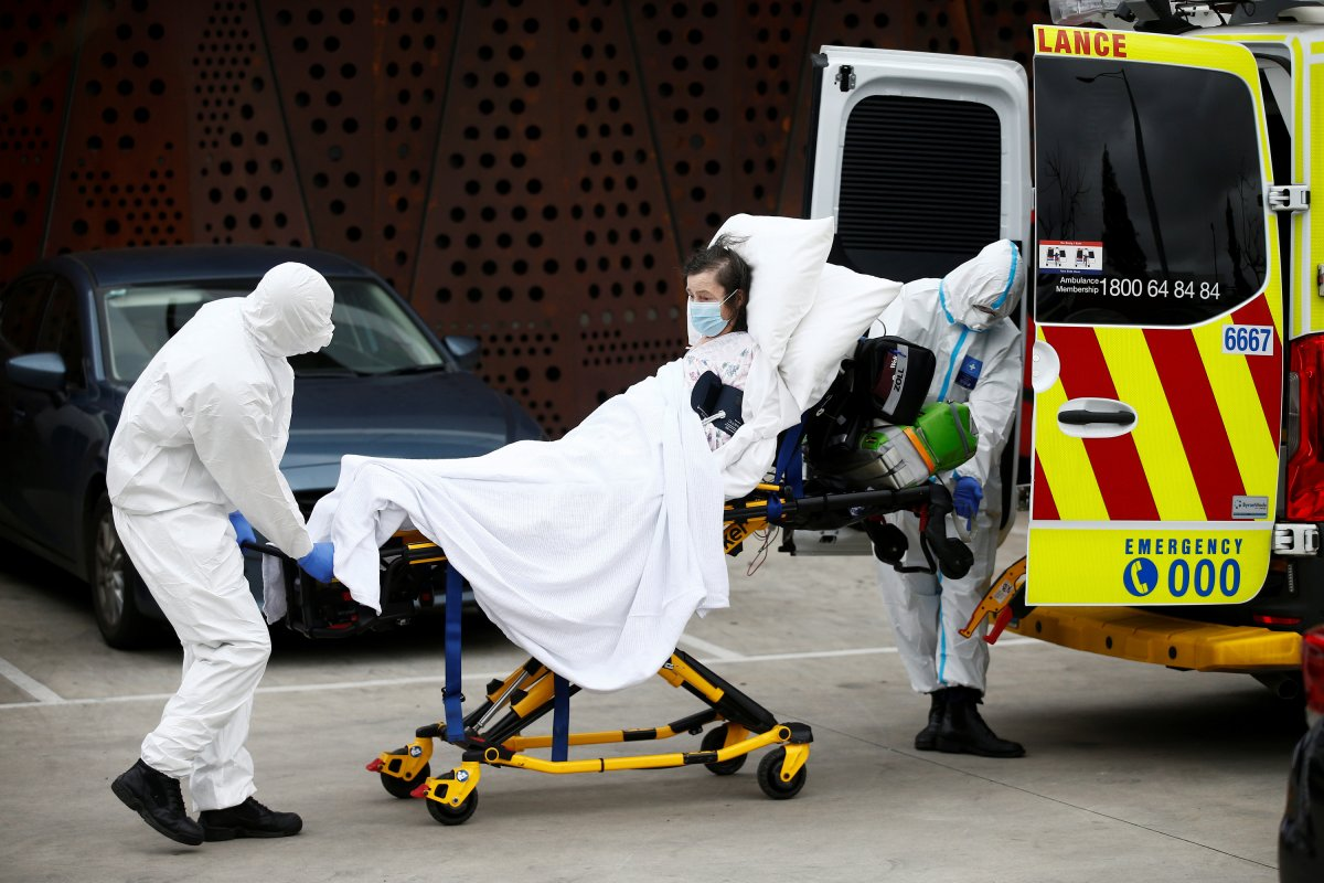 A resident is taken to an ambulance from an aged care facility experiencing an outbreak of the coronavirus disease (COVID-19) in Melbourne, Australia, July 28, 2020.