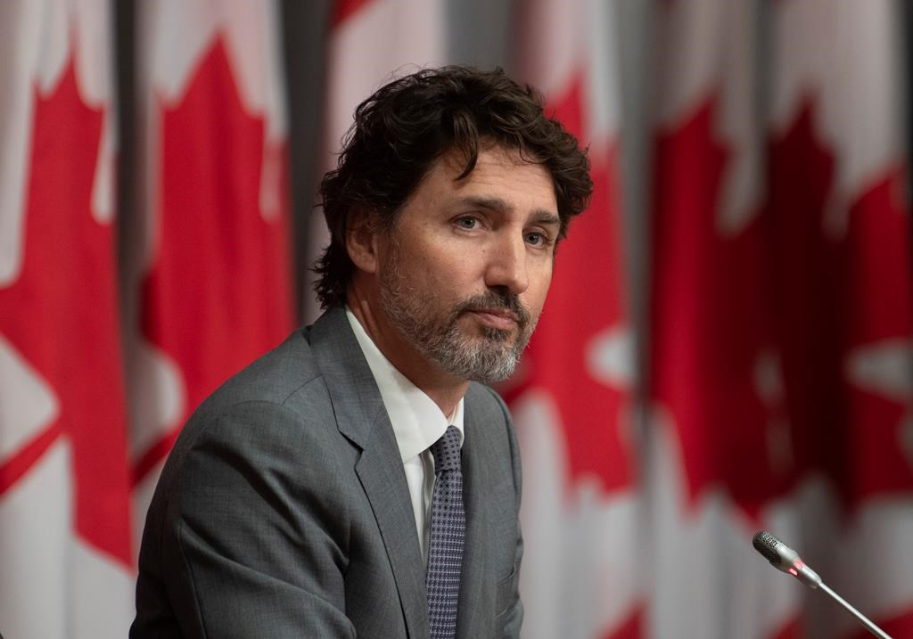 Prime Minister Justin Trudeau listens to a question during a news conference, Wednesday, July 8, 2020 in Ottawa.