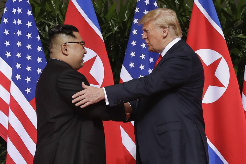 FILE - In this June 12, 2018, file photo, President Donald Trump, right, shakes hands with North Korea leader Kim Jong Un at the Capella resort on Sentosa Island in Singapore. North Korea on Tuesday, July 7, 2020, repeated it has no immediate intent to resume dialogue with the United States hours before U.S. Deputy Secretary of State Stephen Biegun was to arrive in South Korea for discussions on the stalled nuclear diplomacy.