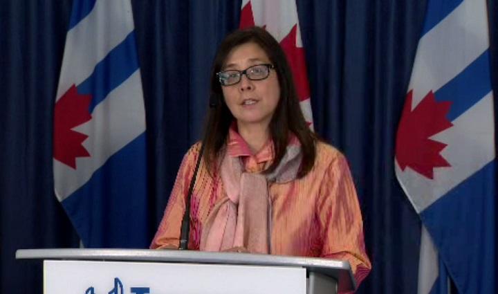 Dr. Eileen de Villa speaks at Toronto city hall on Thursday.