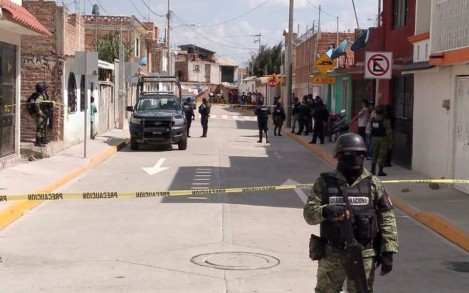Members of the National Guard protect the area where 10 people were killed in the municipality of Irapuato, Guanajuato state, Mexico, June 6, 2020. Twenty-four more people were killed in a shooting at a drug rehab facility in Irapuato on July 1, 2020, though it was not immediately clear if it was the same facility as the June attack.