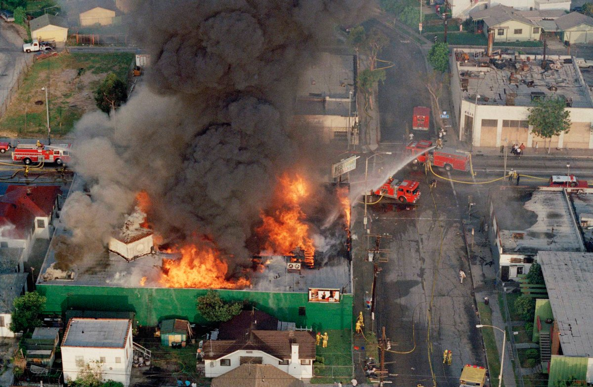 A fire burns out of control at the corner of 67th Street and West Boulevard in South Central Los Angeles on April 30, 1992. The day before, four white police officers were declared innocent in the beating of black motorist Rodney King, and Los Angeles erupted in deadly riots.