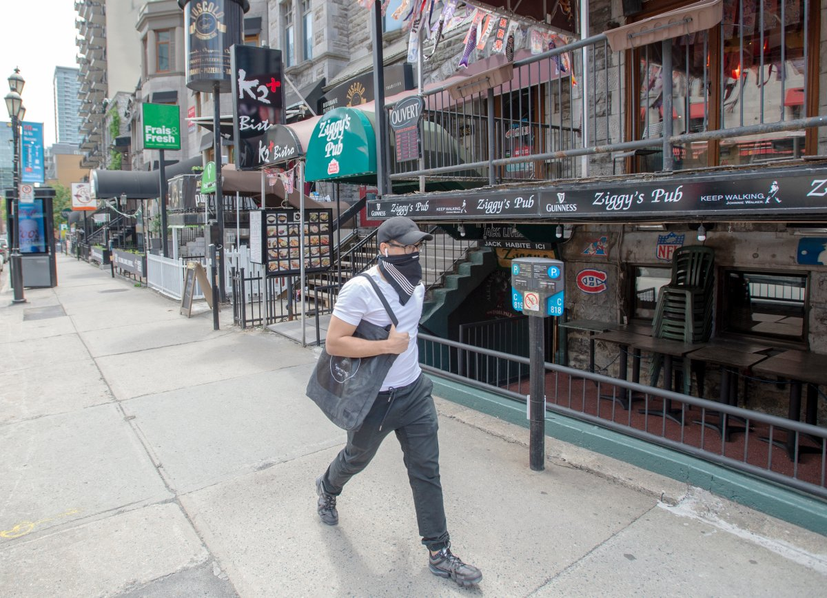 A man walks past closed bars and restaurants on Crescent Street Tuesday June 9, 2020 in Montreal.