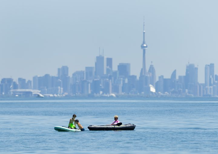 People enjoy activities on Lake Ontario overlooking the City of Toronto skyline during the COVID-19 pandemic at Jack Darling Park in Mississauga on Wednesday, June 17, 2020.