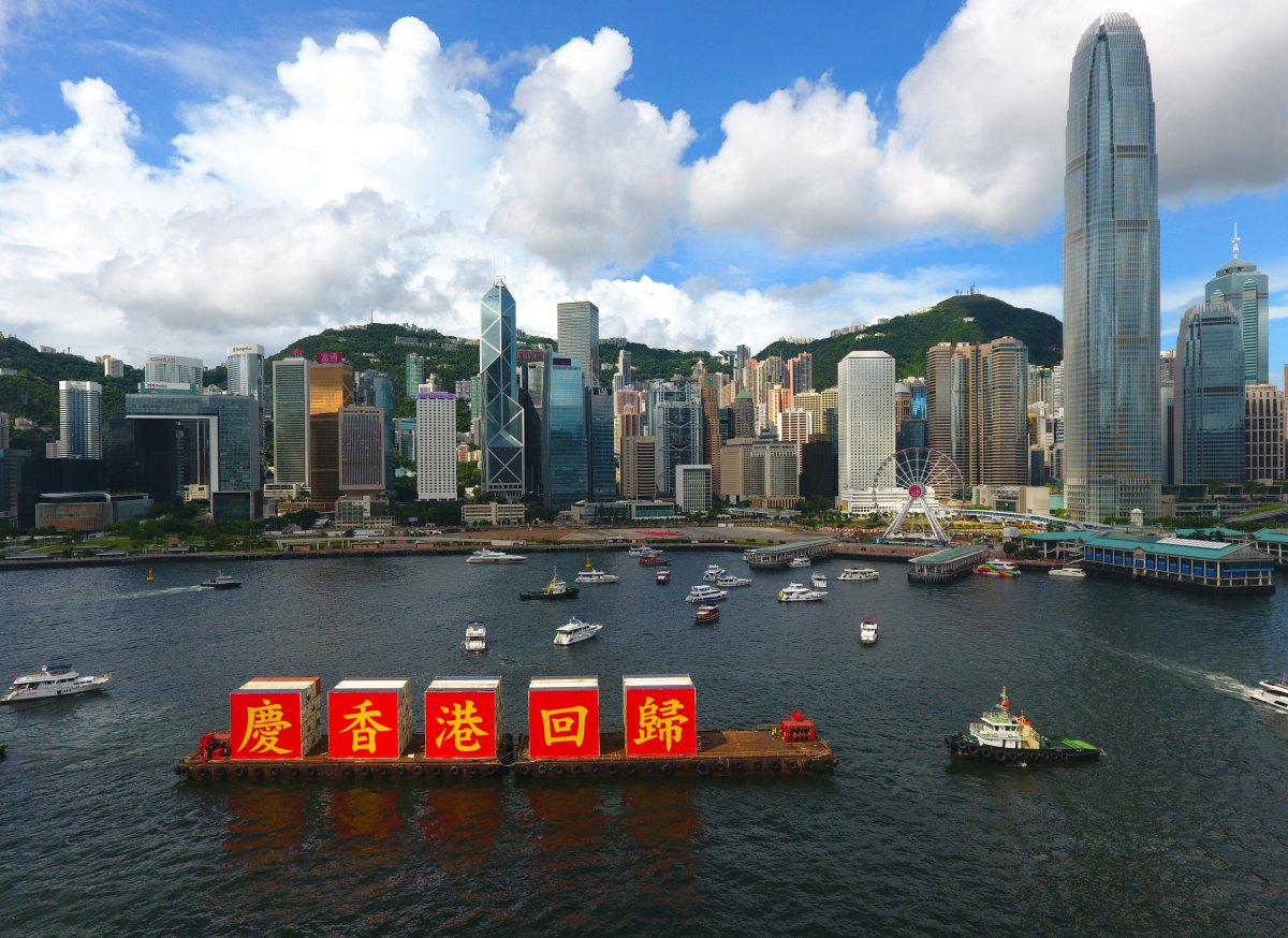 "A ship carrying the slogan of ""Celebrating the 23rd anniversary of Hong Kong's return to the motherland"" sails at the Victoria Harbour in Hong Kong, south China, July 1, 2020."