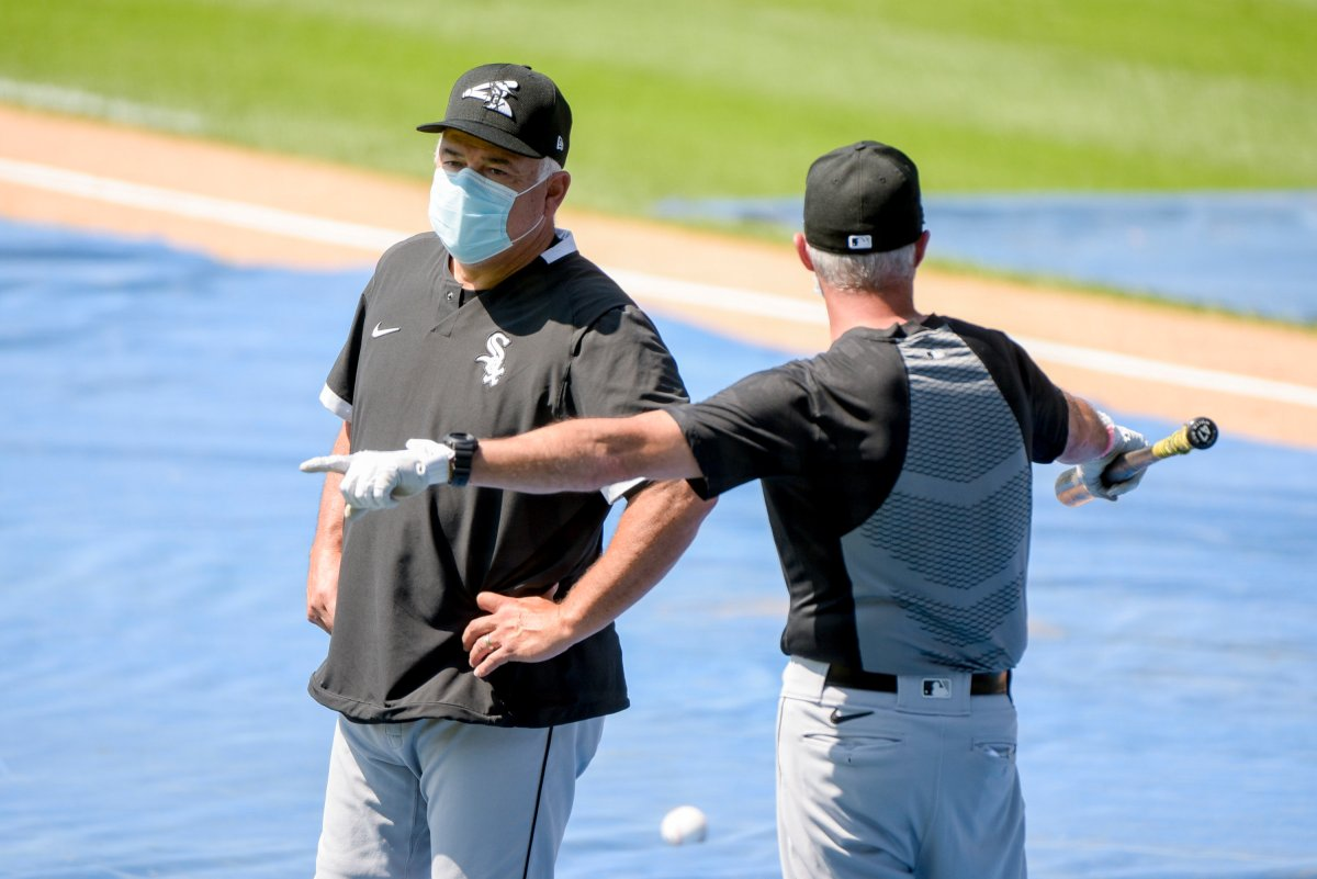 Chicago White Sox Manager Rick Renteria talks with a coach during the first baseball practice of the restarted 2020 MLB season at Guaranteed Rate Field on Friday, July 3, 2020, in Chicago.
