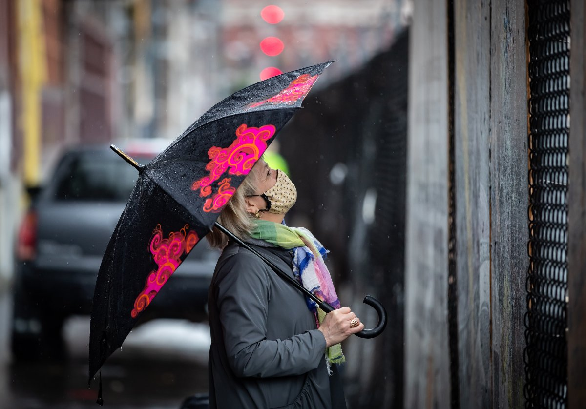 British Columbia provincial health officer Dr. Bonnie Henry wears a face mask as she views the Murals of Gratitude exhibition in Vancouver, on Friday, July 3, 2020. The business improvement association in Vancouver's Gastown neighbourhood honoured Dr. Henry on Friday with a sneak peek at a mural exhibition featuring her image. She also received a pair of John Fluevog that were designed in her honour. THE CANADIAN PRESS/Darryl Dyck.