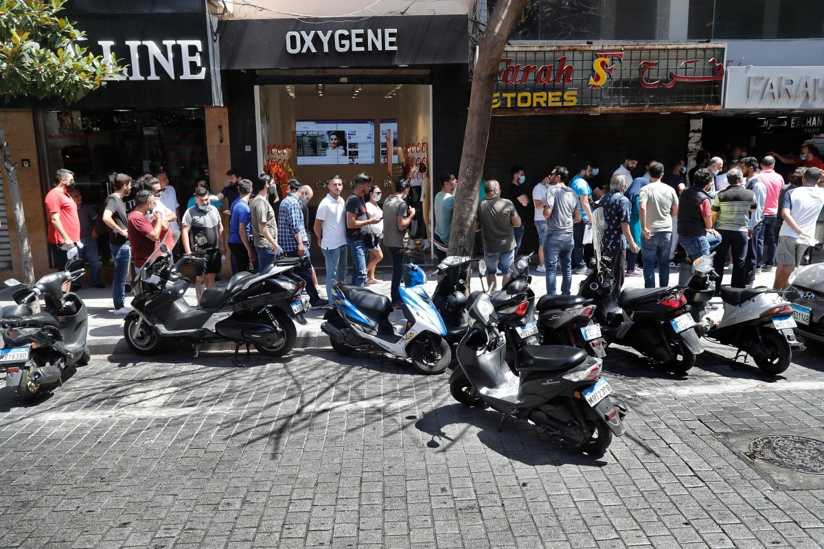 People line up outside an exchange shop to buy U.S. dollars, in Beirut, Lebanon, June 17, 2020.