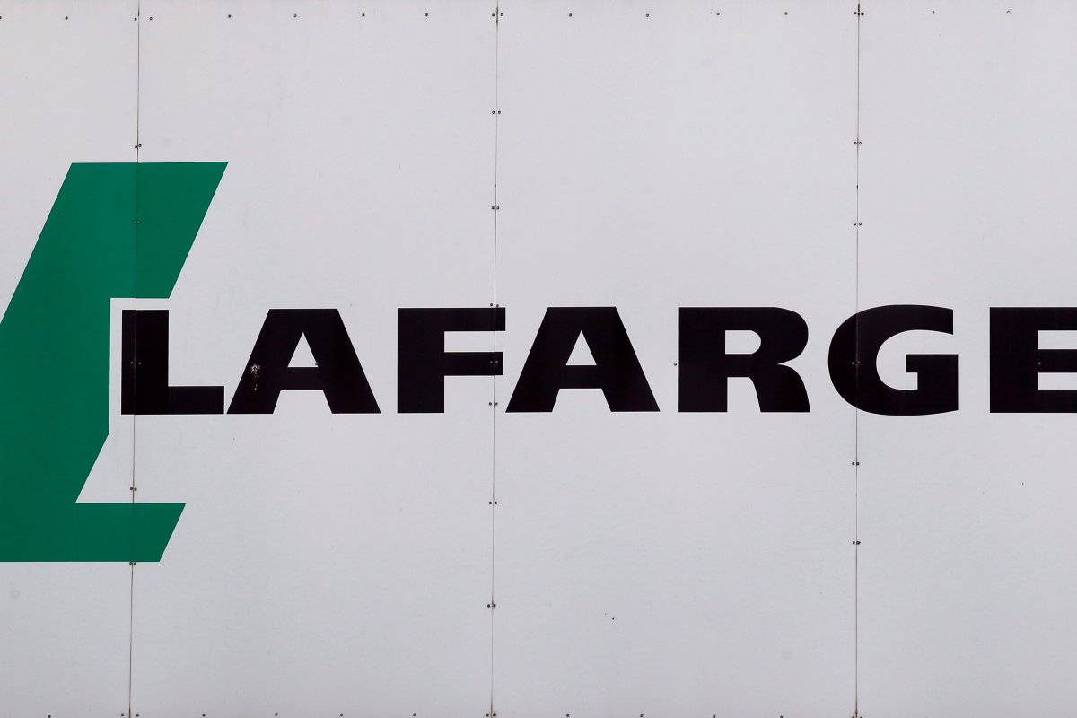 A logo of Lafarge, the world's largest cement maker, is pictured outside of a facility, in Paris, France, Friday Sept. 8, 2017. Construction materials giant Lafarge Canada says it fired an employee after a discriminatory and hateful act took place at a Montreal work site.