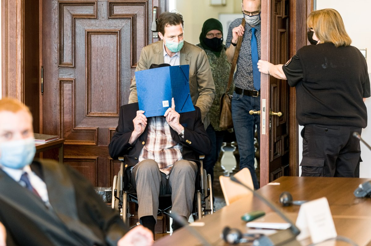 Defendant Bruno Dey is pushed into the courtroom on a wheelchair for the continuation of the trial against him in Hamburg, Germany, 14 July 2020.