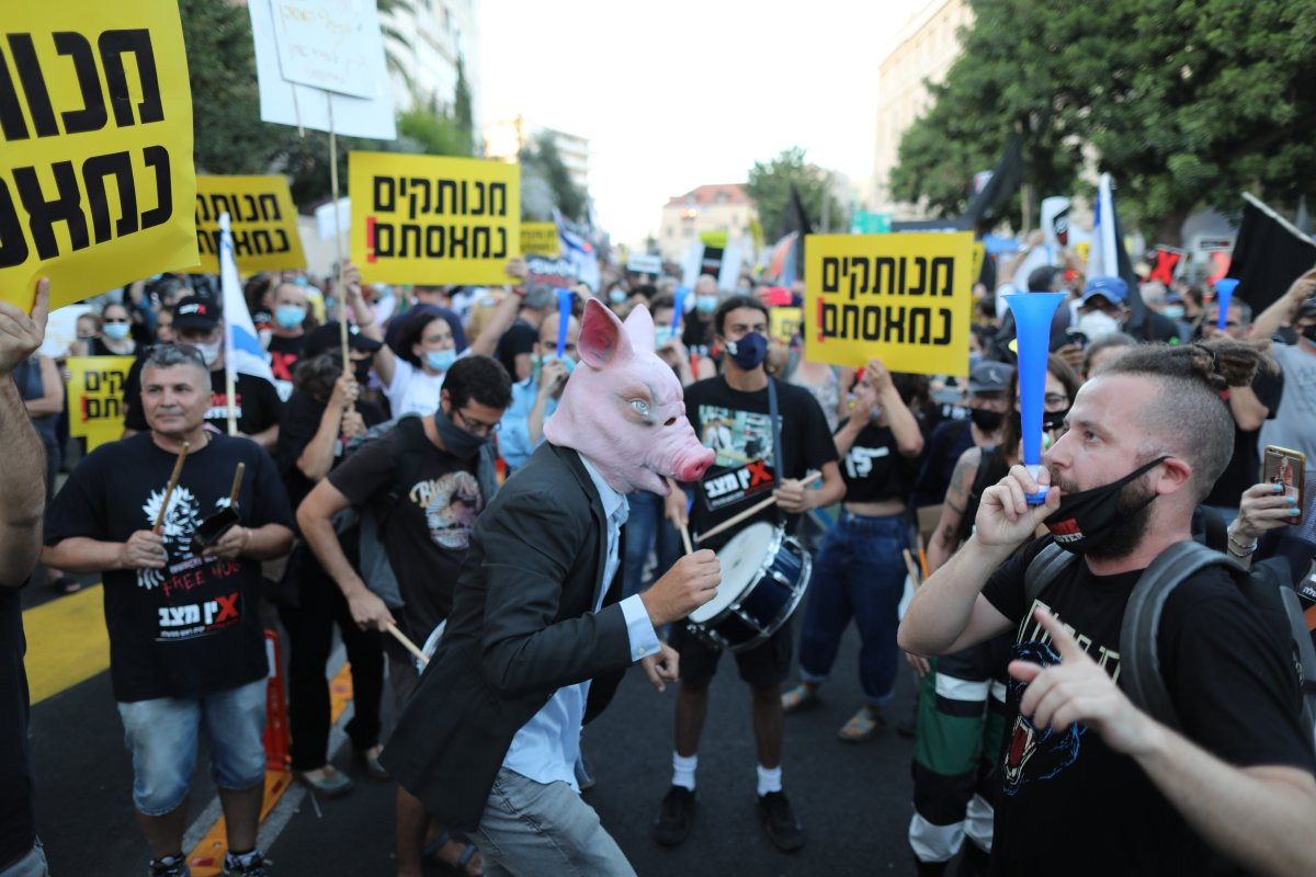 People protest against Israeli prime minister Benjamin Netanyahu due to corruption charges, outside his residence in Jerusalem, Israel, July 14, 2020.