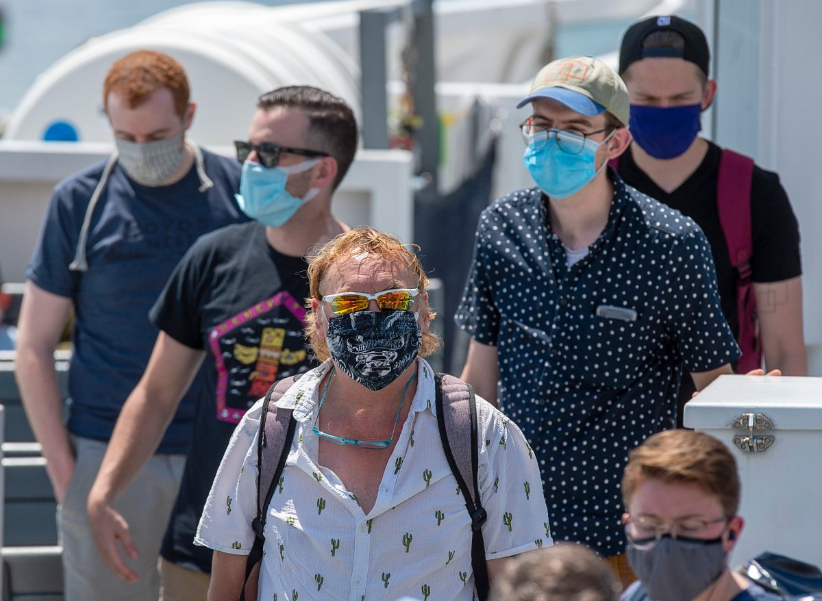 Passengers wear face masks on a Halifax Transit ferry as it arrives in Dartmouth, N.S., on Friday, July 24, 2020.