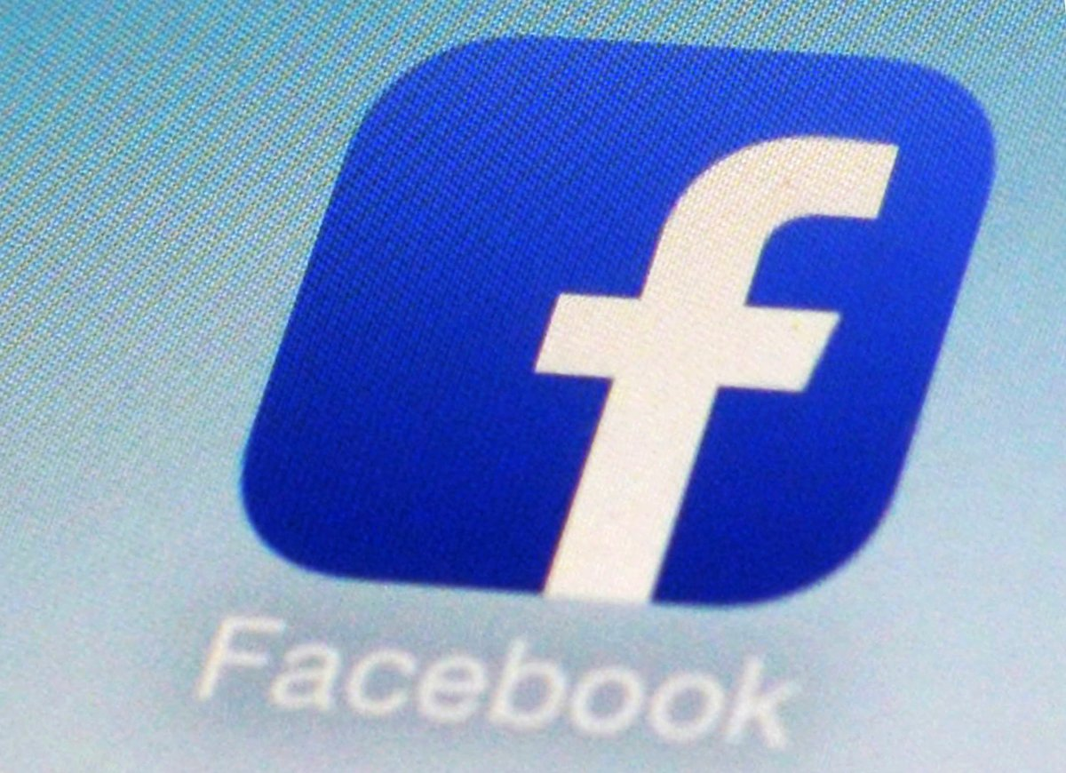 FILE - This Feb. 19, 2014, file photo, shows a Facebook app icon on a smartphone in New York.