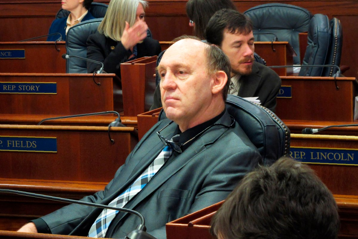 FILE - This Feb. 12, 2018 file photo, Alaska state Rep. Gary Knopp waits during a break in a floor session in which the House failed to elect a permanent speaker  in Juneau, Alaska. The Alaska House Majority says Knopp was killed in the mid-air collision of two planes near Soldotna on Friday, July 31, 2020. Alaska State Troopers would not confirm Knopp's death beyond saying the mid-air collision near the airport in Soldotna was a fatal crash.