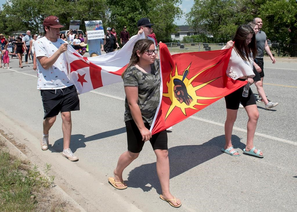 People walk to honour Rodney Levi in Red Bank, New Brunswick on Friday June 19, 2020. Indigenous leaders in New Brunswick are renewing a call for an independent, Indigenous-led public inquiry to investigate systemic racism and two recent police shootings in the province. THE CANADIAN PRESS/Stephen MacGillivray.