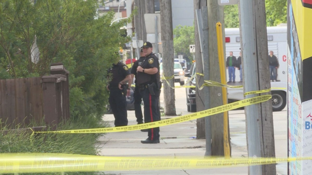 Police on scene after a man was shot and later hit by a car.