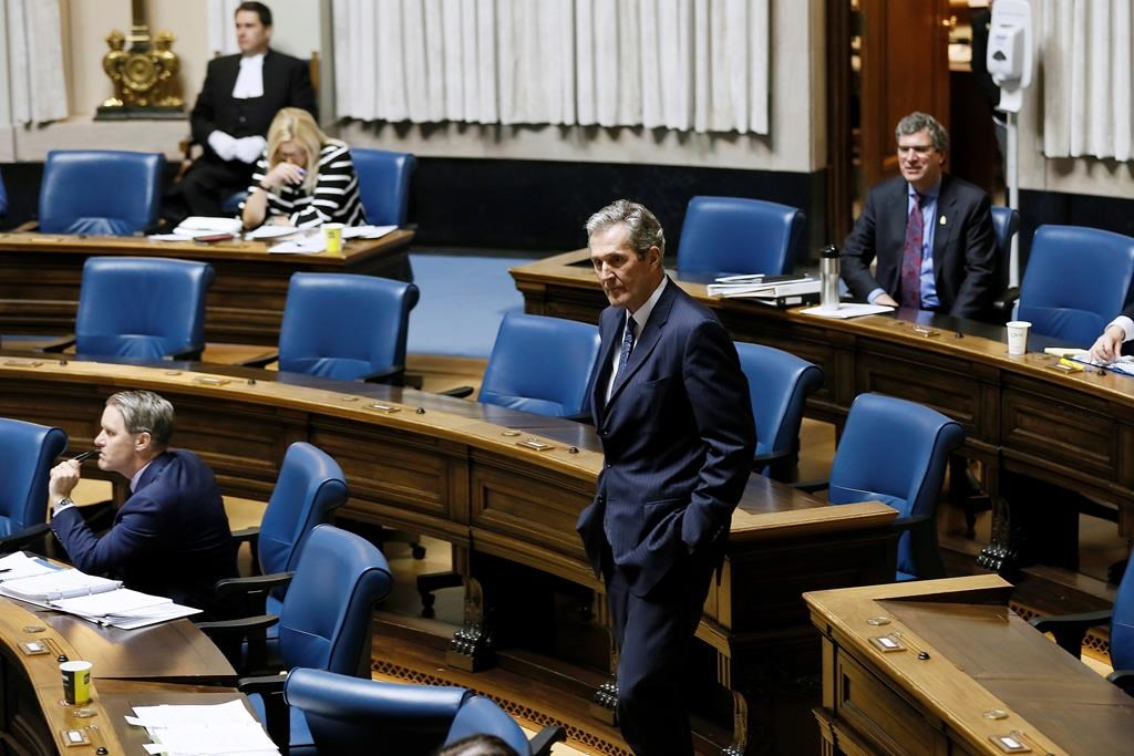 Manitoba Premier Brian Pallister makes his way to his seat during question period at the Manitoba Legislature in Winnipeg, Wednesday, May 6, 2020. A Manitoba Hutterite minister is telling the province to stop identifying colonies where members have tested positive for COVID-19 because it is leading to stigmatization. THE CANADIAN PRESS/John Woods.