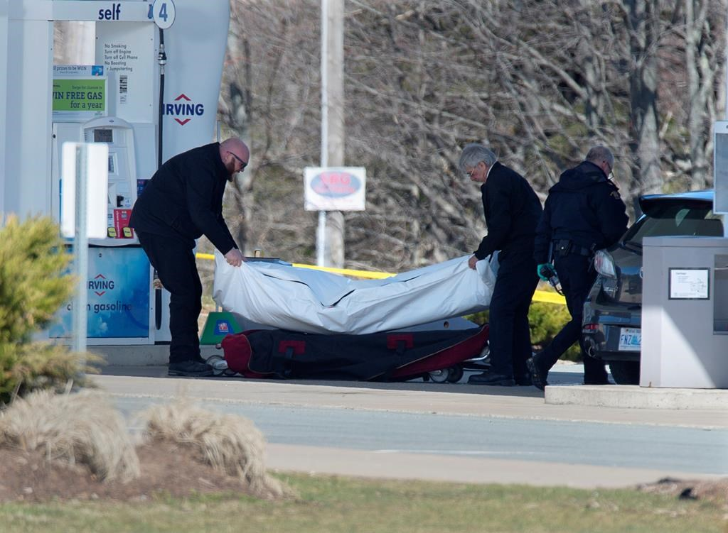 Workers with the medical examiner's office remove a body from a gas bar in Enfield, N.S. on Sunday, April 19, 2020. A coalition of groups devoted to reducing or eradicating gender based violence across Canada is urging Ottawa and Nova Scotia to refrain from using a restorative justice approach for a promised inquiry into the mass killing that claimed the lives of 22 people in the Maritime province.