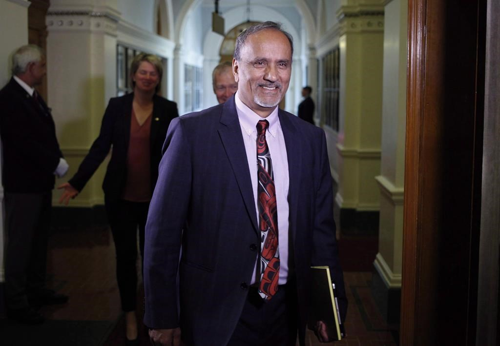 Surrey-Newton NDP MLA Harry Bains arrives to the start of the debate at B.C. Legislature in Victoria on June 26, 2017. Workers' compensation benefits in B.C. would be based on a higher maximum salary amount under legislation introduced Tuesday by the provincial government. THE CANADIAN PRESS/Chad Hipolito.