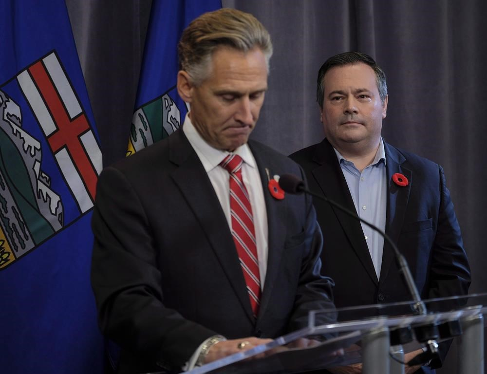 United Conservative Party leader Jason Kenney, right, looks on as MLA Dave Rodney announces his resignation in Calgary, Alta., Sunday, Oct. 29, 2017. A former Alberta legislature member who gave up his seat for Alberta Premier Jason Kenney has a new government job in Texas. Kenney has appointed Dave Rodney to the job of Alberta's agent general. THE CANADIAN PRESS/Jeff McIntosh.