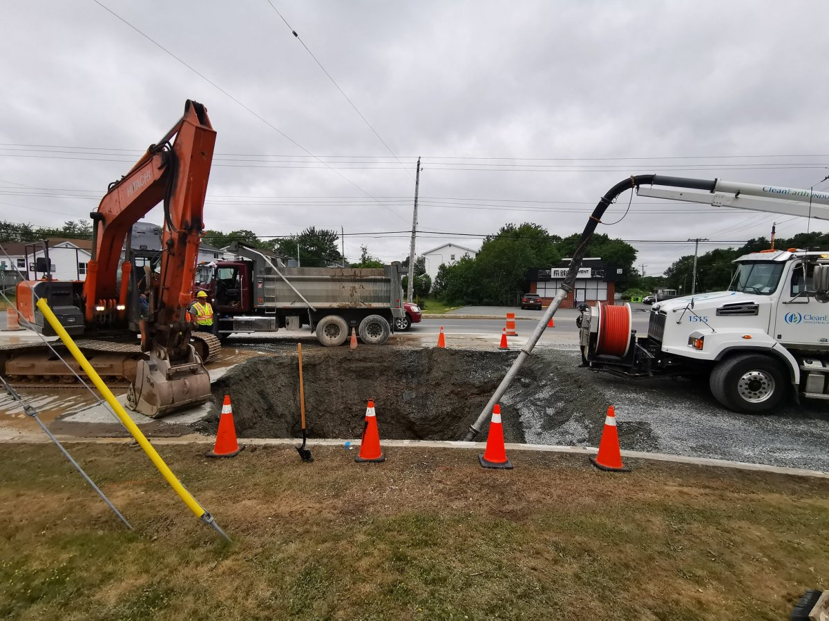 Halifax Water crews conduct repairs on a water main near the intersection of Cobequid Road and Glendale Drive in Lower Sackville, N.S.