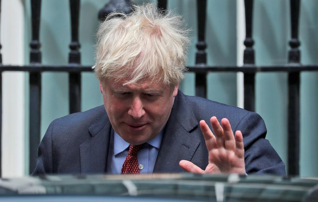 Britain's Prime Boris Johnson leaves 10 Downing Street to attend the weekly Prime Minister's Questions session, in parliament in London, Wednesday, July 15, 2020. (AP Photo/Frank Augstein).