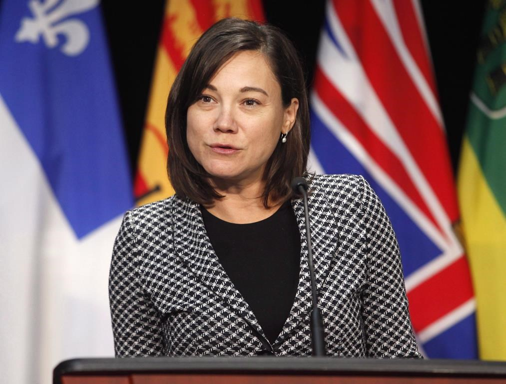 Then-Alberta Minister of Environment and Parks Shannon Phillips speaks at a press conference after a meeting with provincial and territorial environment ministers in Ottawa on Thursday, June 28, 2018.