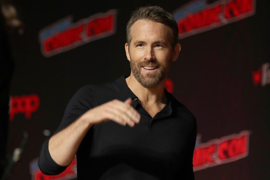 "Ryan Reynolds is seen at New York Comic Con, in New York City, Oct. 3, 2019. The Vancouver-born ""Deadpool"" actor announced plans on Friday for the Group Effort Initiative, which will recruit 10 to 20 trainees from Black, Indigenous and ""all other marginalized communities"" to work alongside experienced professionals on his next movie. THE CANADIAN PRESS/AP-Steve Luciano."