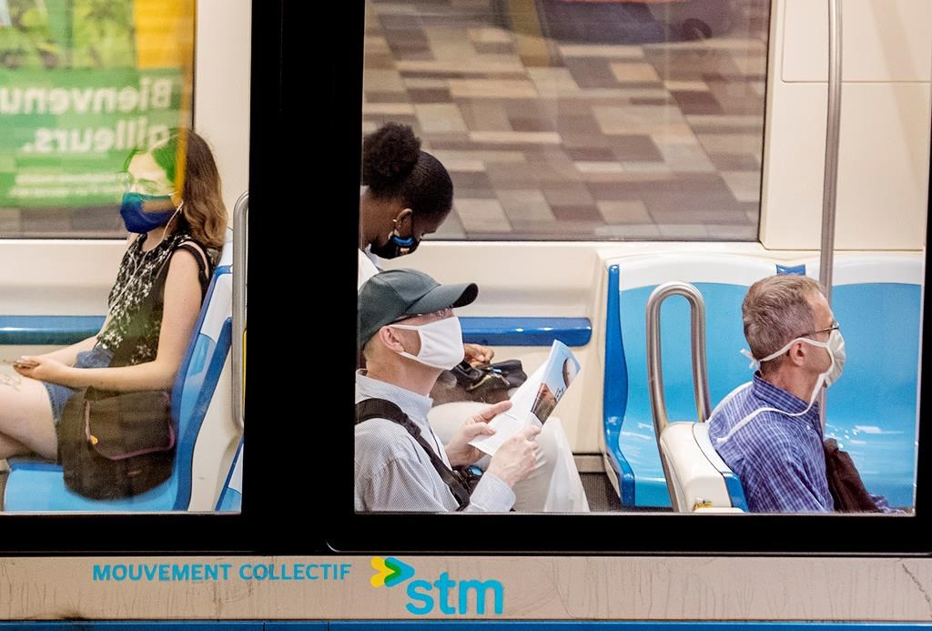 People wear face masks as they commute on a metro in Montreal, Sunday, July 12, 2020. A new suvey looks at Quebecer's perceptions surrounding the novel coronavirus. Monday, Aug. 3, 2020.