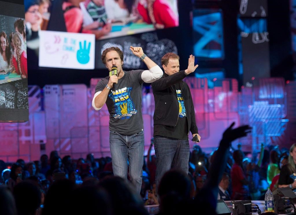 """The co-founders of WE Charity are to testify before a House of Commons committee today as part of a parliamentary probe into a $912-million student-volunteer program. Craig Kielburger and Marc Kielburger speak during """"We Day"""" in Toronto on Thursday, Oct. 2, 2014. THE CANADIAN PRESS/Hannah Yoon."""