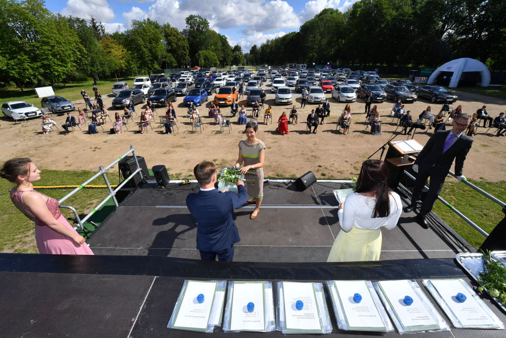 German students have a socially distanced graduation in this recent image.