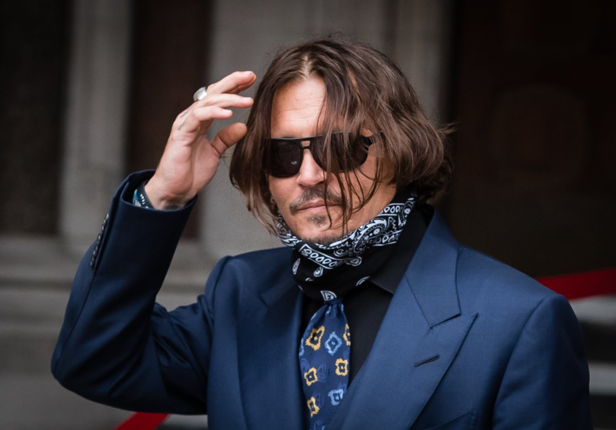 Johnny Depp arrives at  the Royal Courts of Justice, Strand on July 9, 2020 in London, England.