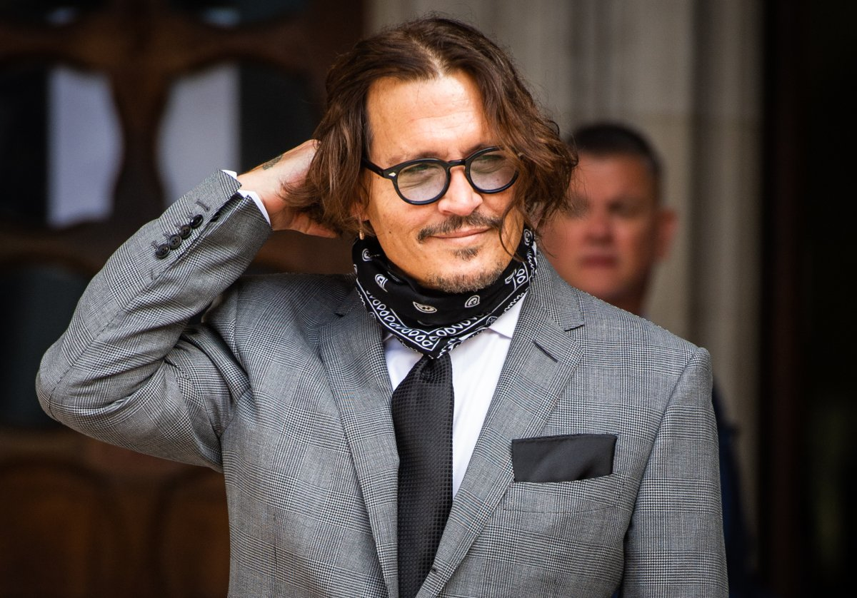 Johnny Depp arrives  at the Royal Courts of Justice, Strand on July 13, 2020 in London, England.