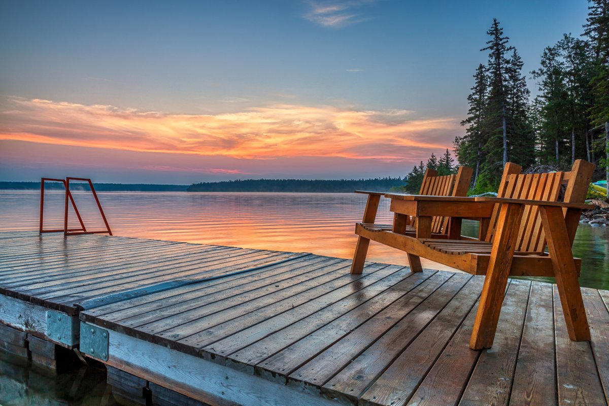 Empty chairs on one of the docks near the old campground in Clear Lake, Riding Mountain National Park, Manitoba Canada,.