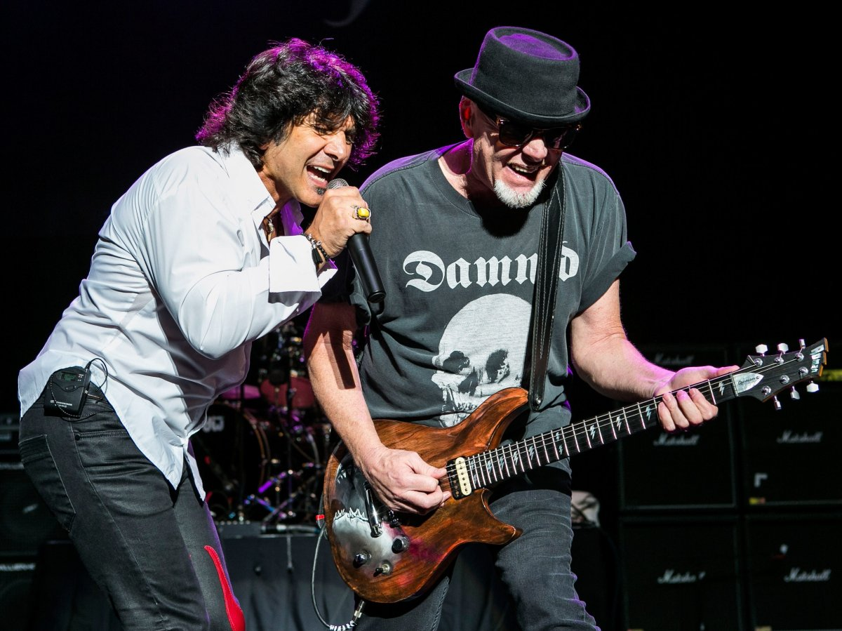 Terry Ilous (L) and Mark Kendall of Great White performs at DTE Energy Music Theater on Aug. 28, 2014 in Clarkston, Mich.
