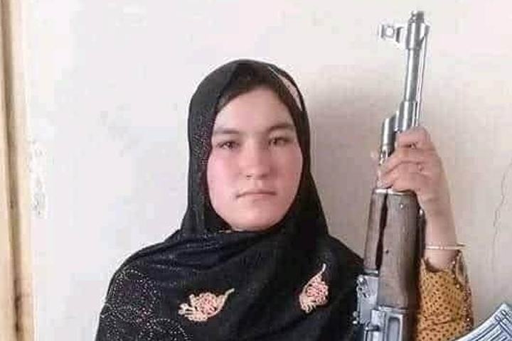 Afghan teenager Qamar Gul is shown with a Kalashnikov-style rifle.