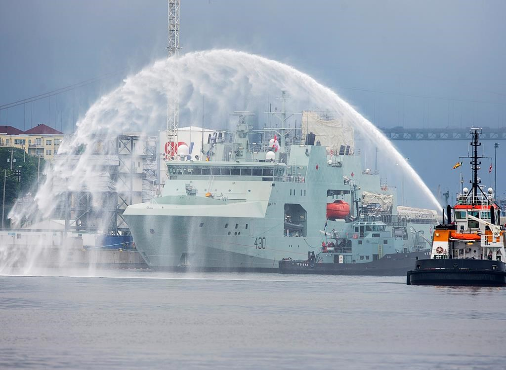 HMCS Harry deWolf heads from the Irving-owned Halifax Shipyard on its way to being delivered to the Royal Canadian Navy dockyard in Halifax on Wednesday, July 31, 2020. The vessel is the first of the new offshore Arctic patrol ships and will conduct surveillance operations, assist in anti-smuggling and anti-piracy operations as well as humanitarian assistance and disaster relief.