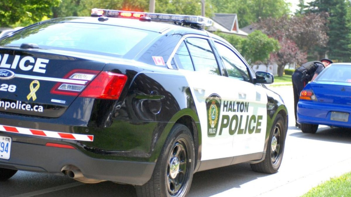 Halton Regional Police say a quarantine compliance officer in facing sexual assault and extortion charges after an alleged incident in Oakville.