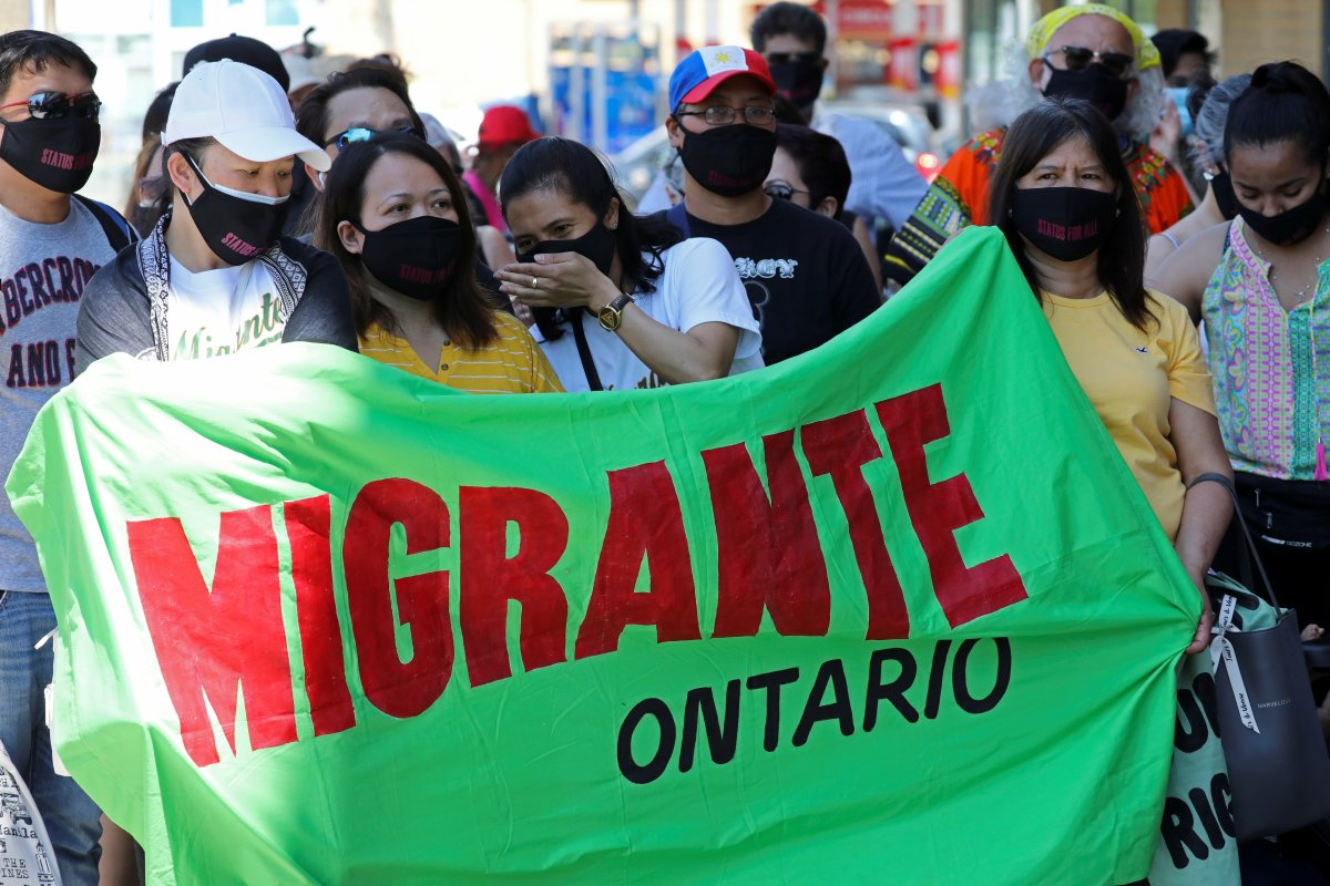 Migrants, refugees, undocumented workers and their supporters rally outside the office Canada's Immigration Minister Marco Mendicino in Toronto, Ontario, Canada July 4, 2020.  REUTERS/Chris Helgren.