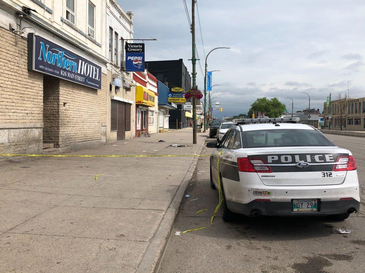 Winnipeg police on Main Street investigating the city's latest homicide.