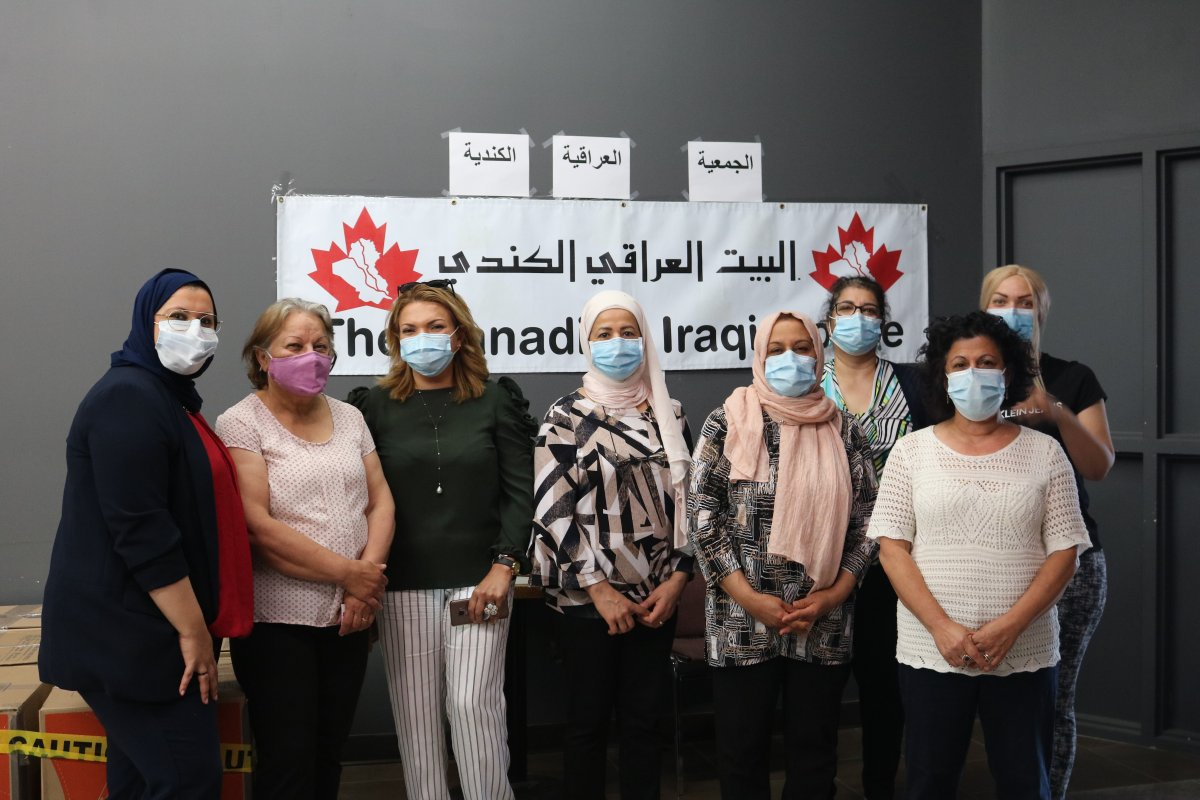 Volunteers helping to assemble 105 parcels of food for Arabic families in need during the novel coronavirus pandemic, London, Ontario July 28, 2020.