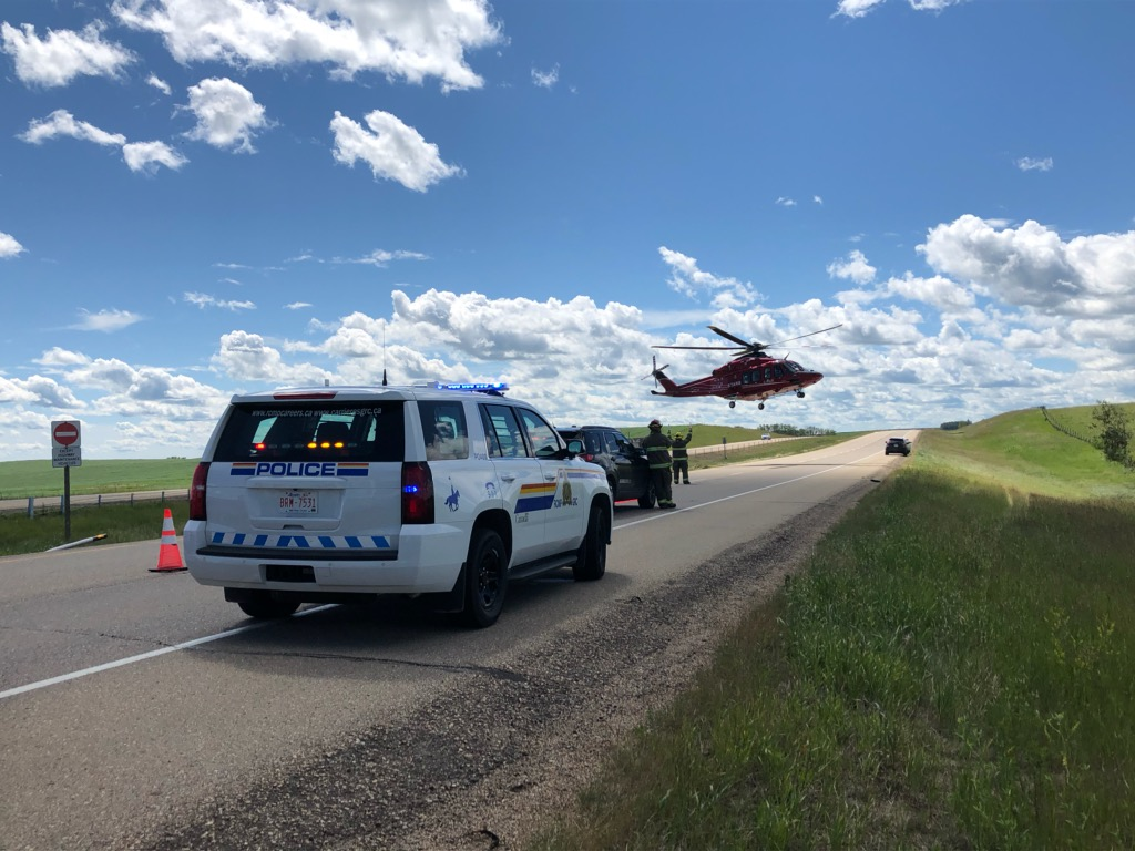 STARS Air Ambulance takes off from a crash site near Ponoka along the QEII highway in Alberta on July 10, 2020.