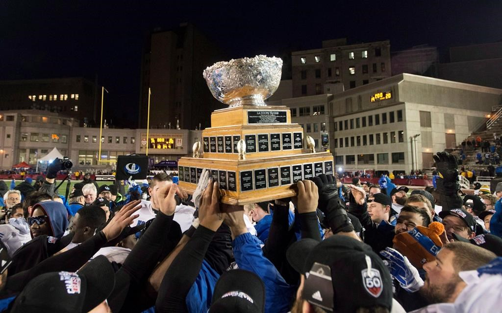 Players from the Montreal Carabins hoist the Vanier Cup after beating the McMaster Marauders in the CIS football final in Montreal on November 29, 2014. Dozens of Canadian football players dreaming of hoisting the Vanier Cup in their fifth and final year of university eligibility have had those hopes dashed. The cancellation of the 2020 national football championship game because of COVID-19 and U Sports not altering an age eligibility rule accelerates the swan song of roughly 300 football players. THE CANADIAN PRESS/Graham Hughes.