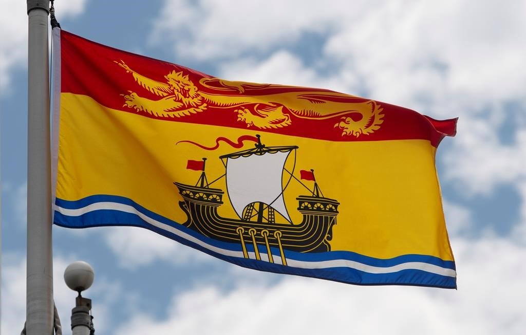 New Brunswick's provincial flag flies on a flag pole in Ottawa, Friday July 3, 2020. THE CANADIAN PRESS/Adrian Wyld.