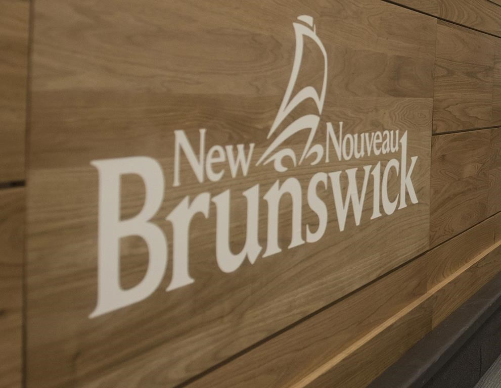 The New Brunswick logo is shown during a press conference in Fredericton, N.B., on February 17, 2020. THE CANADIAN PRESS/Stephen MacGillivray.
