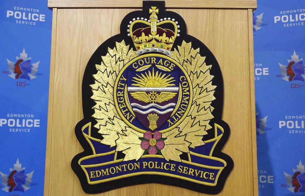An Edmonton Police Service logo is shown at a press conference in this file photo.