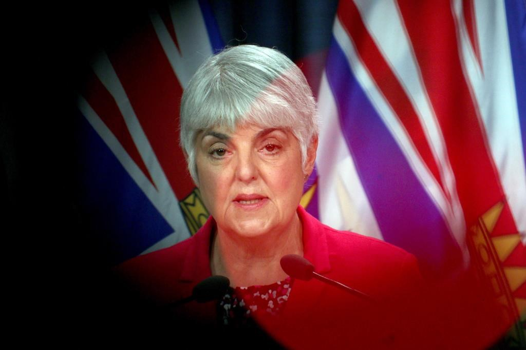 Minister of Finance Carole James speaks to the media during a press conference at Legislature in Victoria, B.C., on Monday, March 23, 2020. THE CANADIAN PRESS/Chad Hipolito.