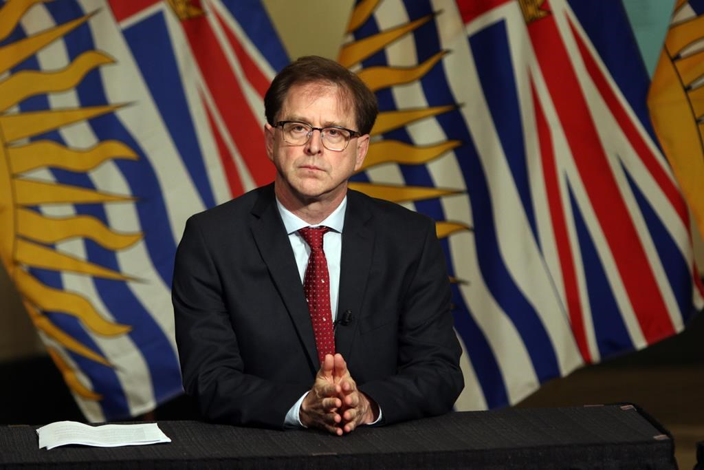 Health Minister Adrian Dix looks during a press conference in the rotunda at Legislature in Victoria, B.C., on Wednesday May 6, 2020. British Columbia's health minister says the province has hired more staff and increased operating-room hours to catch up on cancelled surgeries but a significant surge in COVID-19 cases could impact recovery. THE CANADIAN PRESS/Chad Hipolito.