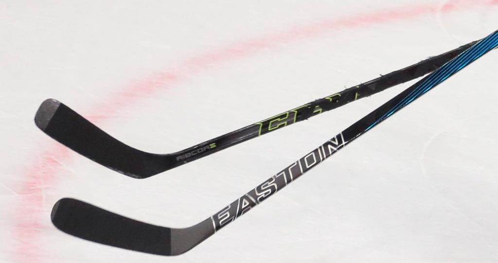 Players' sticks are shown during the Ice Hockey World Championships Group A match between Russia and Denmark, in Moscow, Russia, on Thursday, May 12, 2016. A junior men's hockey team has dropped its Indigenous mascot and name. The Neepawa Natives announced the change Wednesday, saying they would also be dropping their logo of a stereotyped Indigenous man with feathers in his hair. THE CANADIAN PRESS/AP, Ivan Sekretarev.